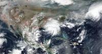 ناسا ترصد العواصف الاستوائية ودخان حرائق الغابات فى صورة واحدة