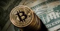 منصة coinbase توقف مؤقتا معاملات بيتكوين بربع مليون دولار بعد اختراق تويتر