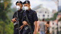 الشرطة الماليزية تداهم مكاتب الجزيرة بسبب تقرير يشوه سمعة البلاد